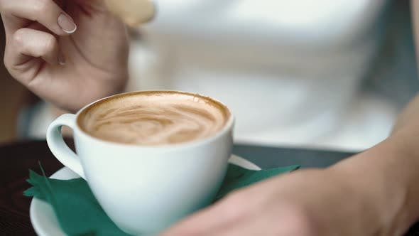 Thumbnail for Girl Stirs Coffee with a Spoon, Dripping Drops, Close-up, Slow Motion