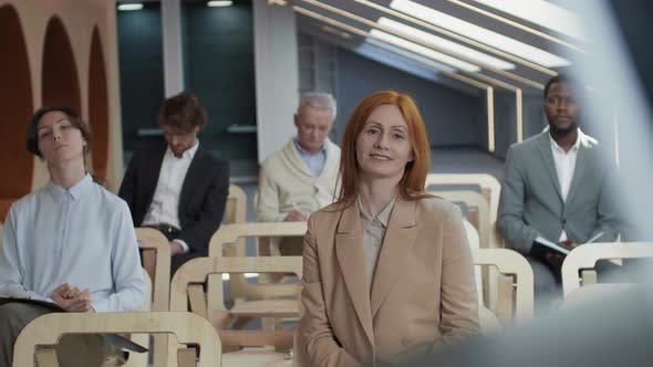 Red-haired Female Journalist Asking Question during News Conference