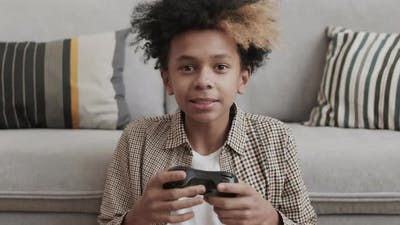 African Boy with Console Controller