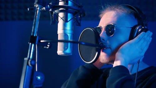 Male Rap Singer Sings Hip Hop in Microphone