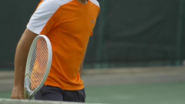 Thumbnail for Tennis player practicing returning serves.