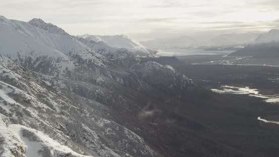 Thumbnail for Aerial helicopter shot, flying overhead a vast glacier, drone footage