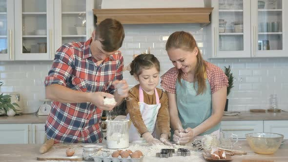 Thumbnail for Family with Little Daughter Has Fun with Dough at Table