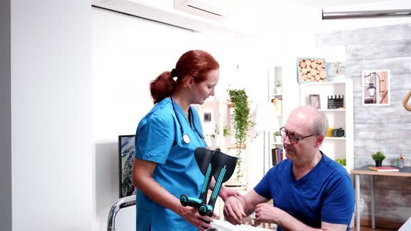 Thumbnail for Female Doctor Helping Old Man To Walk with Crutches