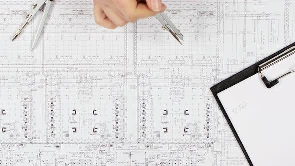 Thumbnail for Engineers Are Sitting at the Table Analyzing the Drawing. Close Up