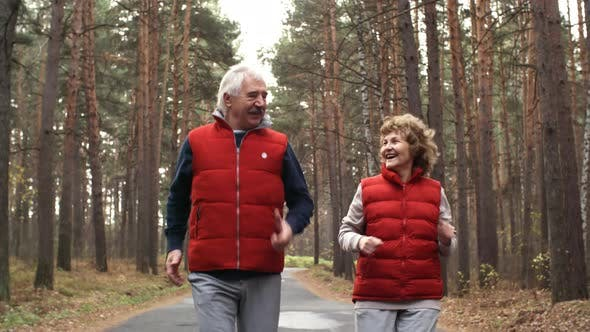 Thumbnail for Senior Couple Jogging in Woods