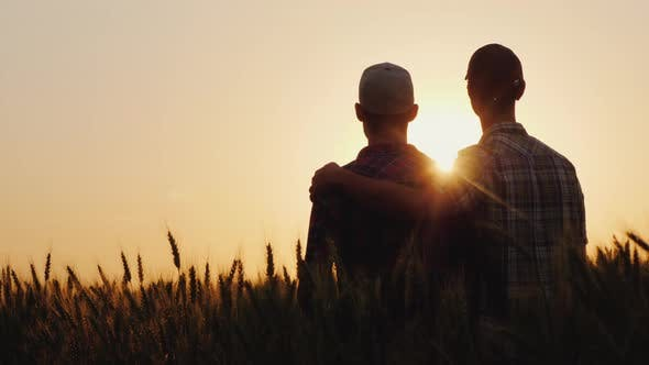 Thumbnail for Two Young Men Hugging Against the Backdrop of the Sunset, Looking Forward To the Horizon