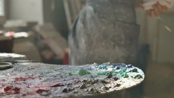 Thumbnail for Woman in Dirty Apron Takes Oil Paint Drawing in Art Studio