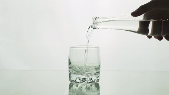 Thumbnail for Water Is Pouring From Bottle Into Glass