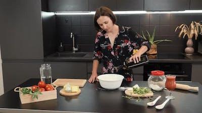 Adding olive oil to flour