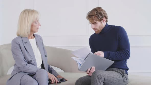 Thumbnail for Middle-aged Businesswoman and Young Businessman Working