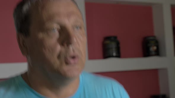 Sweaty senior man exercising on running machine