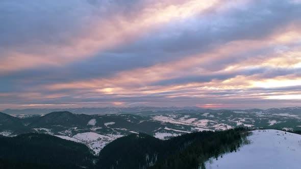 Thumbnail for Aerial View in Sundown Winter Mountain