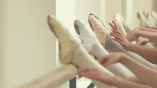 Close Up Legs of Ballerinas at Barre