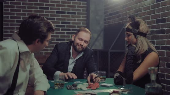 Male Player Opens the Cards in Combination and Rejoices