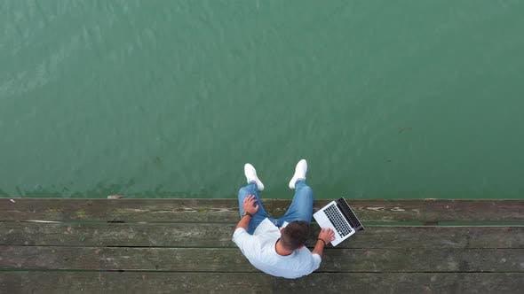 Thumbnail for Freelancer Using Laptop On A Pier