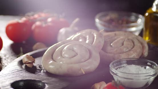 Thumbnail for Raw Sausages with Tomatoes and Spices Rotate.
