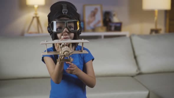 Thumbnail for Little Girl Child Child Plays In A Helmet And Glasses