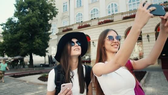 Thumbnail for Two Tourist Girls Taking Photo on Phone