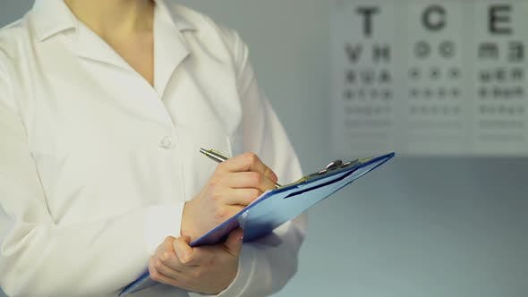 Thumbnail for Female Ophthalmologist Examines Patient
