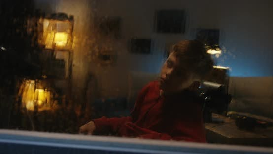 Thumbnail for Wheelchaired Boy Watching Storm From Room