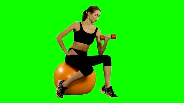 Thumbnail for Girl Sitting on Pilates Ball and Exercising with Dumbbells. Green Screen