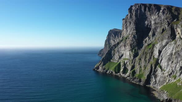 Thumbnail for Norwegian rocky coast and mountain ridge