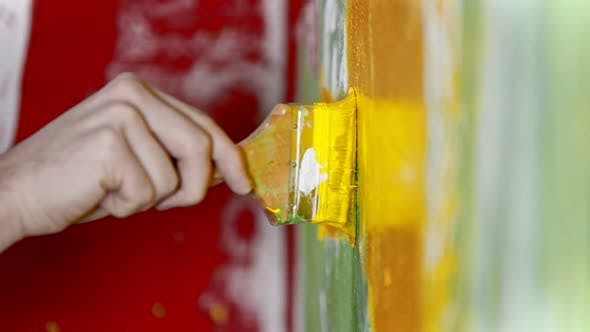 Thumbnail for Painting Wall with Yellow Color Paint Using a Synthetic Brush - Interior Design