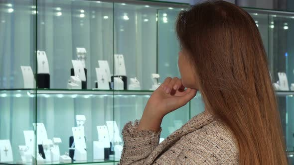 Thumbnail for Young Female Customer Smiling, Choosing Jewels for Sale at the Luxury Store 1080p