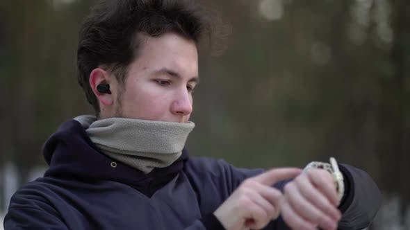 Runner Using Smartwatch Fitness Tracker