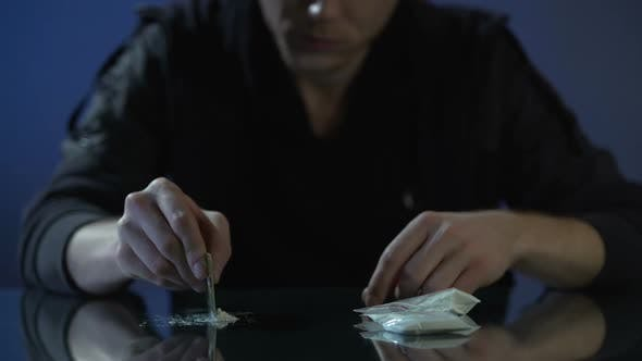 Cover Image for Drug Addict Forming Cocaine Lines on Table, Dangerous Substance Dependence