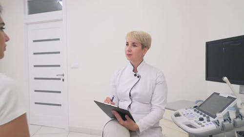 Patient Explaining Problem to Doctor