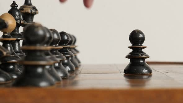 Black player  pawn moving over  chequered fields 4K 2160p 30fps UltraHD  footage - Wooden chess set