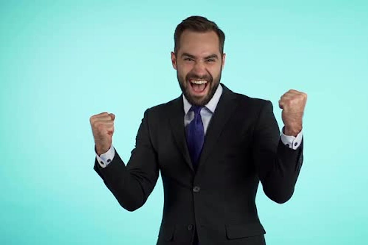 Yes winner gesture. Amazed european businessman with beard shocked, saying  yeah. by Kohanov on Envato Elements