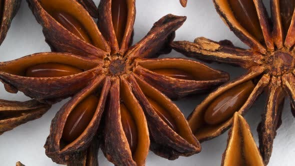 Thumbnail for Shooting of Heap of Star Anise Fruits. Slowly Rotating on the Turntable Isolated on the White