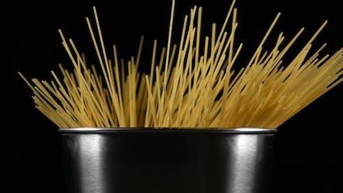 Bunch of Spaghetti Falls in a Pot
