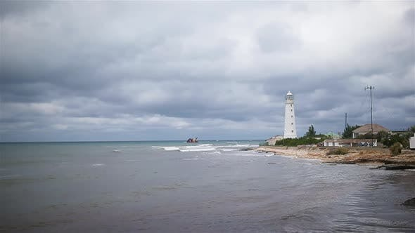 Thumbnail for Seascape with Beautiful White Lighthouse Against Stormy Sk and Sea