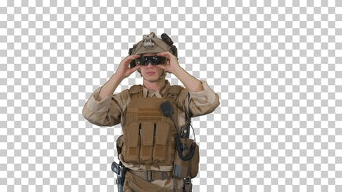 Soldier preparing tactical gear for action battle, Alpha Channel