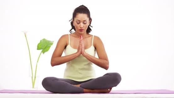 Thumbnail for Beautiful Latina meditating on yoga matt