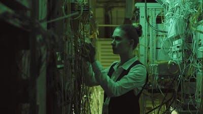 Female Engineer in Data Center Room