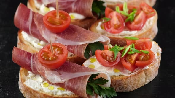bruschetta with italian prosciutto or ham top view