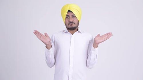 Bearded Indian Sikh Businessman Shrugging Shoulders