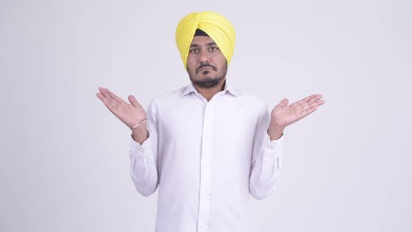 Thumbnail for Bearded Indian Sikh Businessman Shrugging Shoulders