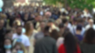 Silhouettes of People Walking in a Crowd