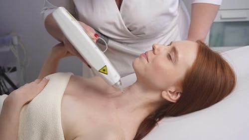 Cosmetologist Performs Fractional Laser Skin Treatment To Restore and Rejuvenate the Female Skin