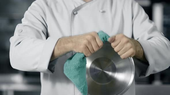 Cover Image for Chef Man Preparing To Cook at Kitchen Restaurant. Closeup Hands Wipe Bowl