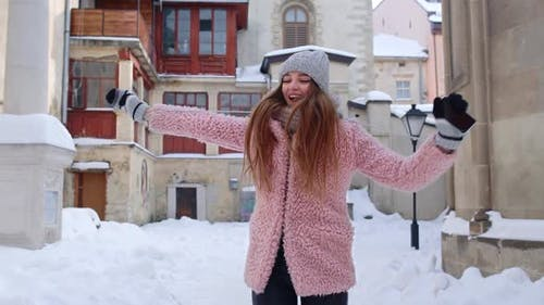 Woman Traveller in Winter City Reading Online Sms Mobile Phone Winning Prize Dancing Celebrating