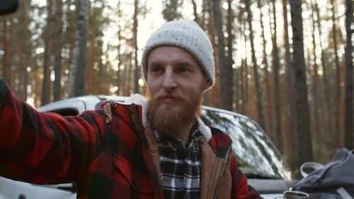 Bearded Traveler Posing for Smartphone Selfie