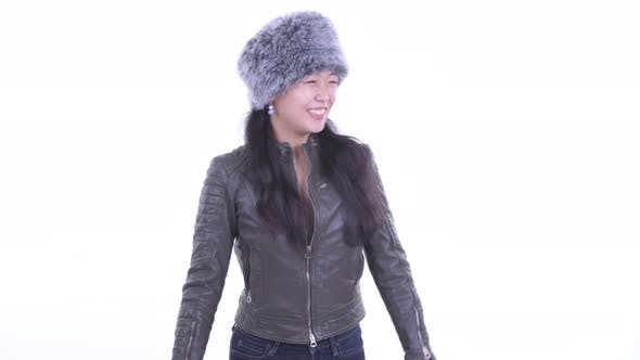 Thumbnail for Happy Beautiful Asian Woman Waving Hand Ready for Winter