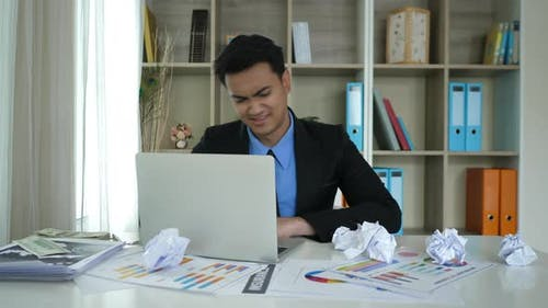 Tired businessman sitting with hard work and bored everything